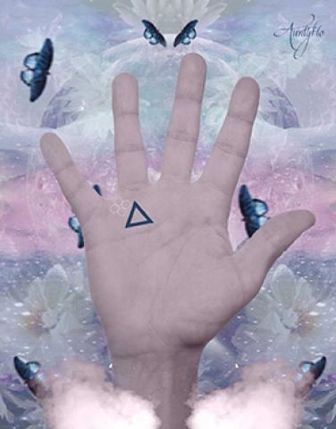 strange symbol near psychic triangle palm reading