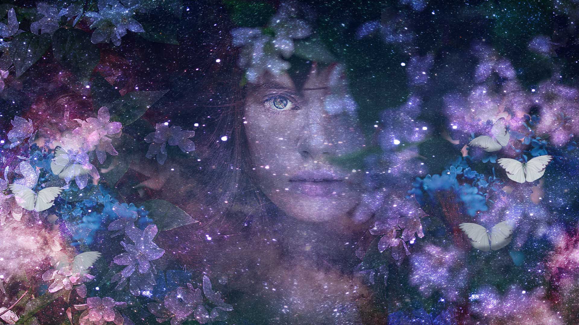 The face of a woman in the centre with flowers around her, butterflies, stars and the expane of space in the background
